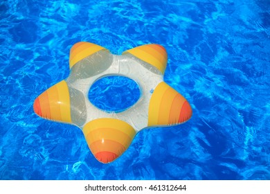 Floating rubber star on a background of blue water