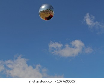 a floating silver sphere