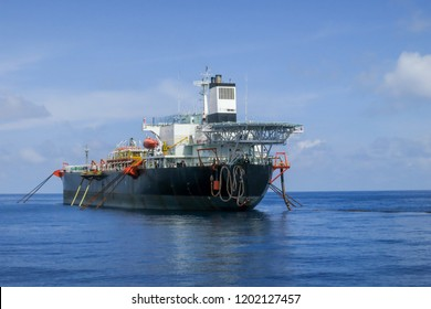 Floating Storage Offloading tanker ship or also known as FSO floating in the open sea.