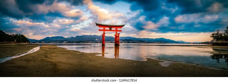 Floating Torii gate of Itsukushima Shrine at Miyajima, Hiroshima, Japan at the . (gate sign reads Itsukushima Shrine)