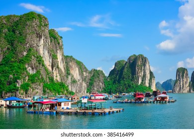 Floating village near rock islands in Halong Bay, Vietnam, Southeast Asia