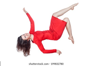 Floating woman in a red dress on a white background.