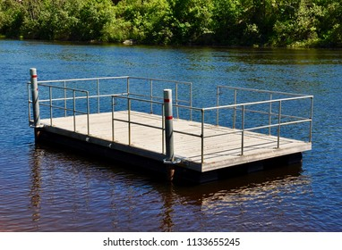 Floating wooden dock in middle of river