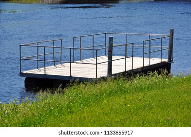 Floating wooden dock near the river banks