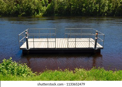 Floating wooden dock in the river