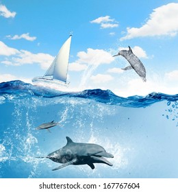 Floating yacht and dolphins swimming under water
