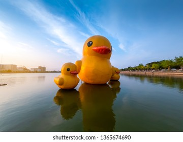 Floating yellow rubber ducks at sunset on the Nong Prajak lake at Udon Thani, Thailand.