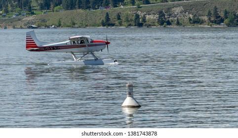 Floatplane on lake getting ready for takeoff