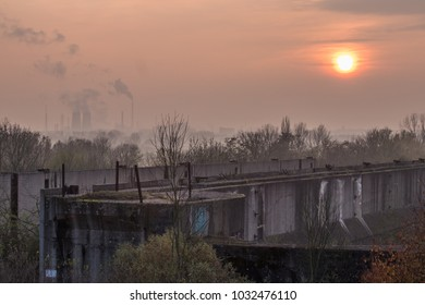 A flood gate near Leuna, Saxony-Anhalt, Germany at moon rise with industry in the background