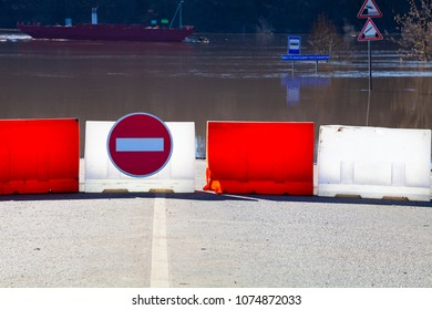Flood on the river Oka, Russia. Beautiful spring landscape with a flooded river and a flooded road. Road is blocked by a road sign and a fence.Flooded traffic signs.