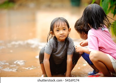 Flood, poverty kids playing