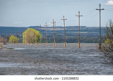 The flood of the river Don. Dangerous water level on the road towards Tryokhostrovskaya ferry station, Ilovlinsky district.