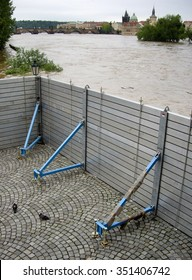 flood roadblocks on the embankment on the background of Charles Bridge, Vltava, Prague, Czech republic