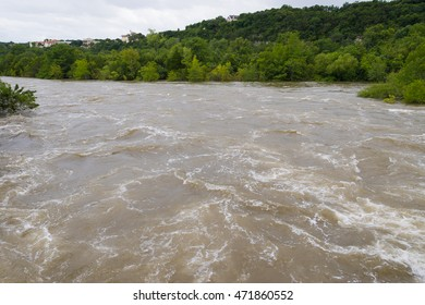 flood waters heading downstream after heavy rains completely change the normal look of the Colorado River