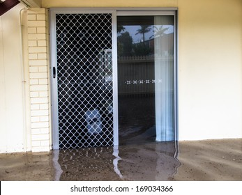 Flood waters running through a screen door