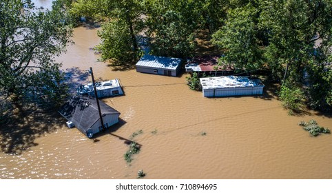 Flood waters totally submerge homes and buildings as hurricane Harvey destroys everything along the Texas gulf coast August 30th 2017 drone view above houses