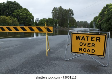 Flooded australian road with road block