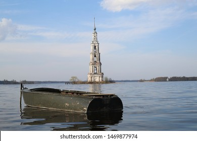 Flooded Belfry and a boat. The Kalyazin Bell Tower, Neoclassical campanile rising to a height of 74.5 metres over the waters of the Uglich Reservoir on the Volga River. The bell tower on the island.