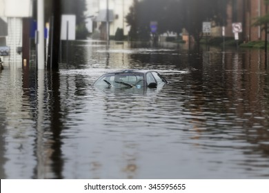 A flooded car in deep water.