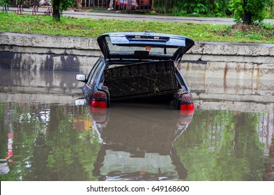 Flooded car. Natural disasters, floods.