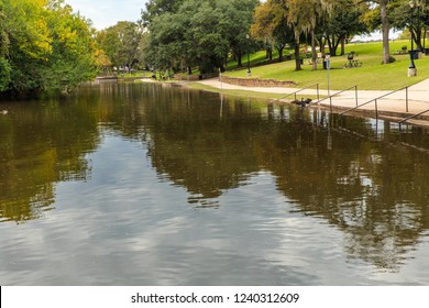 The flooded Comal River at Prince Solms Park in New Braunfels, Texas