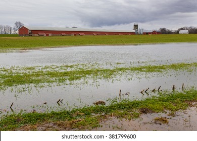 Flooded field with chicken house on farm after winter storm