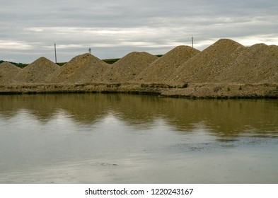 Flooded gravel pit. Extraction of natural resources.