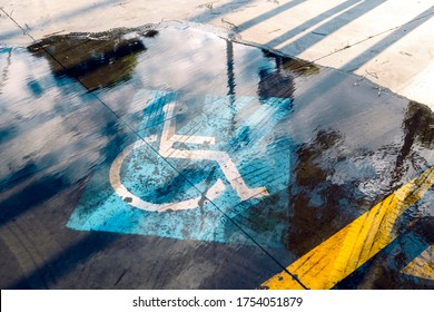 Flooded handicapped sign on the outdoor parking lot.