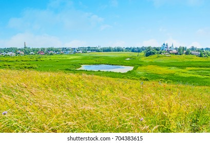 The flooded plain, named Ilinskiy meadow, is the perfect location to relax, enjoy the nature, fragrant wildflowers and watch the tallest bell towers of Suzdal, Russia.
