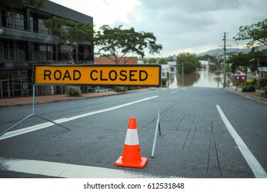 Flooded road in Brisbane and Road Closed sign