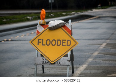 Flooded road sign in Pescadero, San Mateo County, California from February, 2017 winter storm.