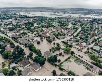 Flooded village on Ukraine. Natural disaster in village Halych, courtyards and streets in dirty water. Global catastrophe, climate change, flood concept