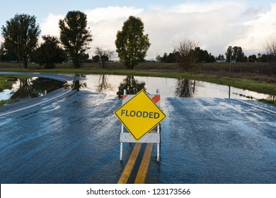 Flooded warning sign on an impassable road, San Martin, California