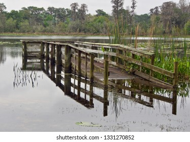 A Flooded Wooden Dock on a Pond