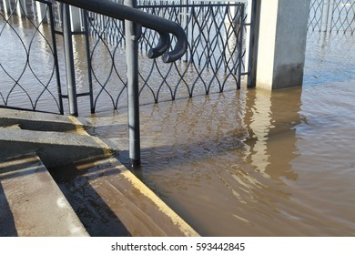 Flooding in the city on the river. Texture of water. Flood near the stairs.