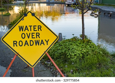 Flooding Disaster Water Over Roadway Street Sign Reflective Pond