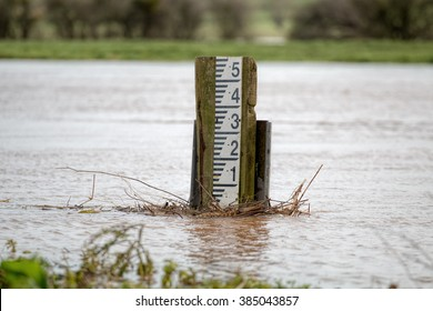 Flooding River. High Water Level Marker Gauge