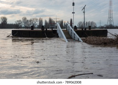 Flooding in winter on the Rhine with a bridge and flotsam