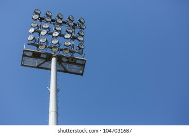 Floodlight mast against a blue sky