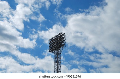 floodlight stadium on a background of sky with white clouds