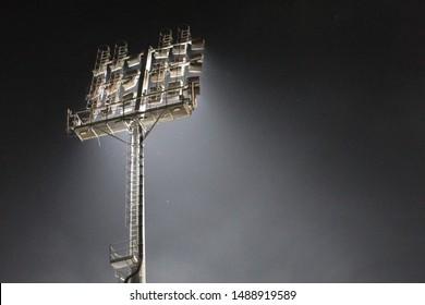 Floodlights illuminating a football stadium at night