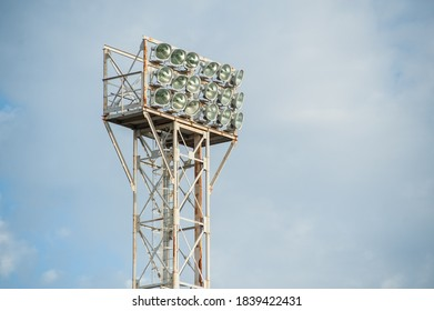 Floodlights over the field with clouds in the background.