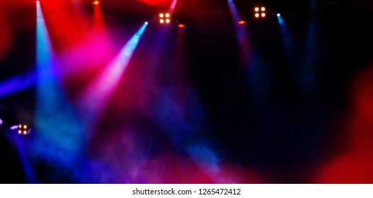 floodlights scene during a rock concert. Blurred background. Web banner. Element of design.