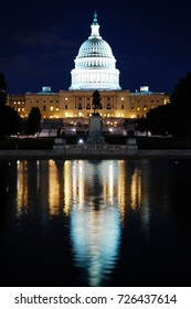 The floodlit dome of the United states Capitol also shines in the reflection pool
