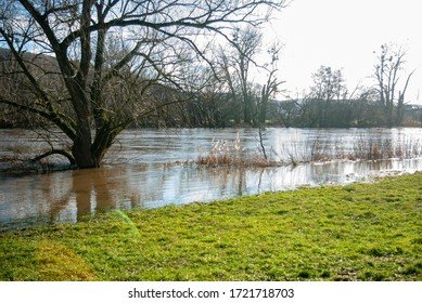Floods on the river Main with strong currents near Großwallstadt in March 2020 in backlight