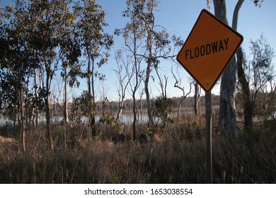 Floodway sign in bushy area