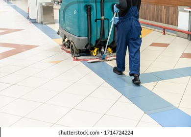 Floor care and cleaning services with washing machine in supermarket. disinfection and sanitization