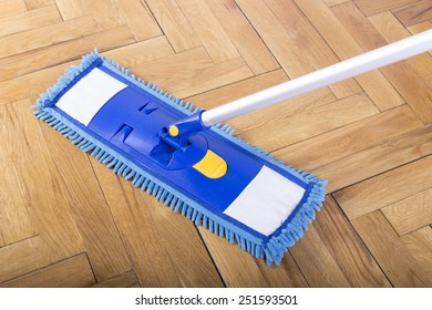 Floor cleaning mop on parquet
