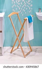 Floor clothes hanger in bathroom, towels drying on a hanger