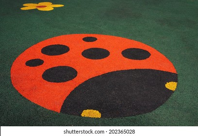 Floor covering children's playground with a ladybug